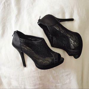 Black lace high heel pumps
